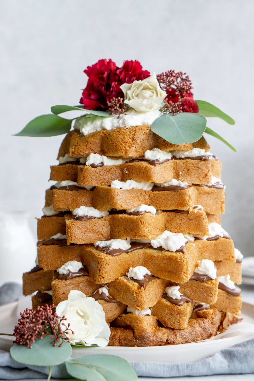Pandoro tree with nutella and whopped cream on a plate