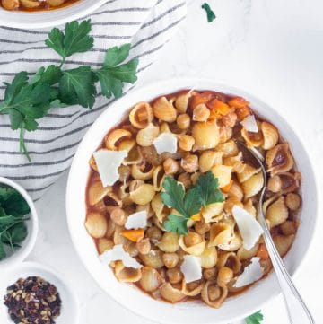 Chickpea soup in a bowl with parsley sprinkled around