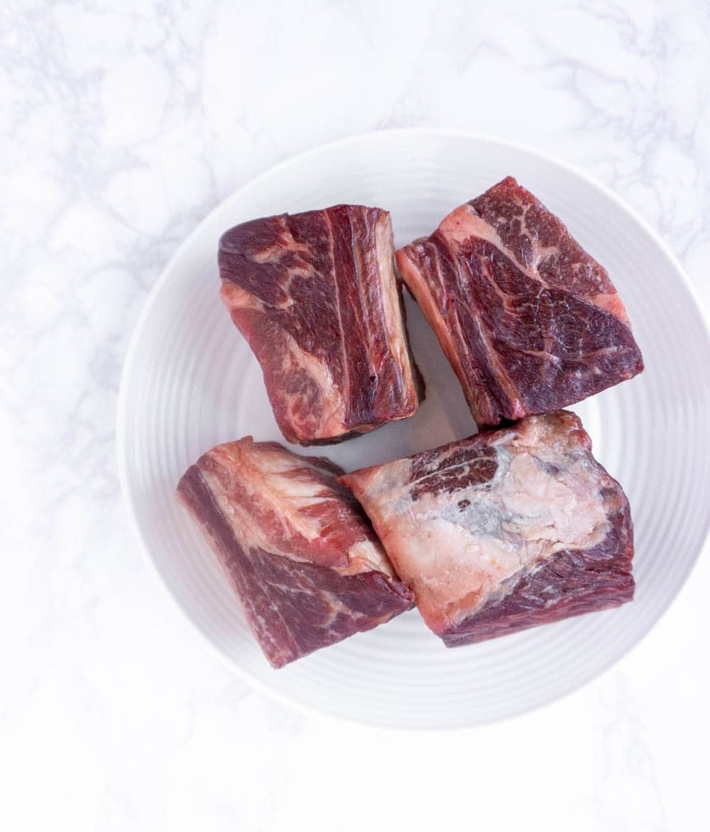 beef short ribs on a white plate