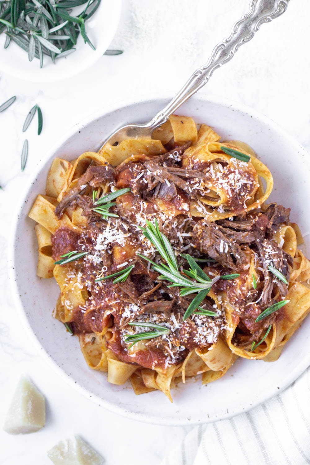 overhead photo of beef short rib pappardelle in a plate