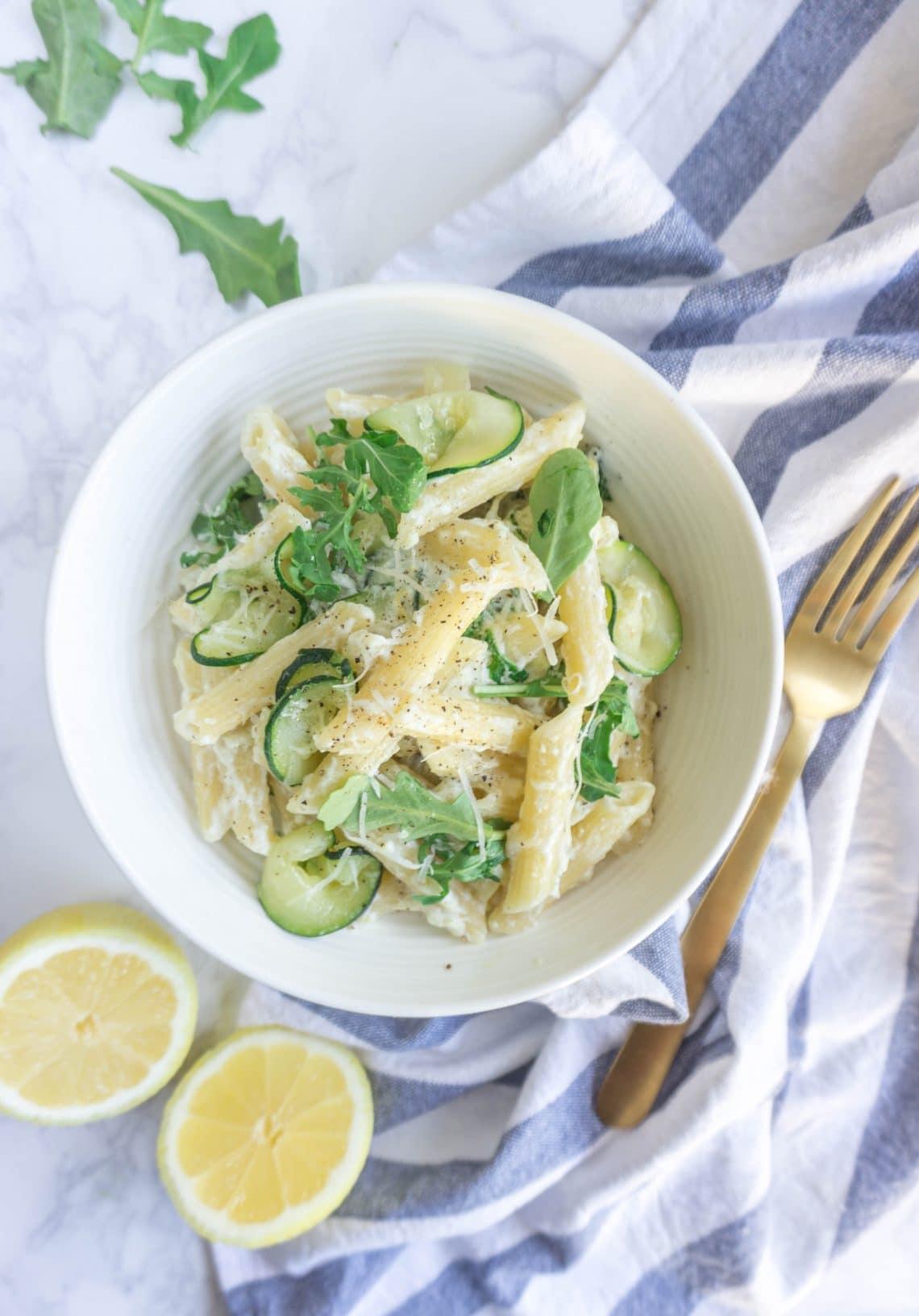 Penne pasta with lemony ricotta, zucchini and arugula