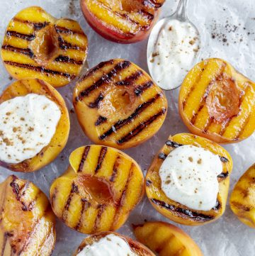 Overhead shot of grilled peaches topped with ricotta