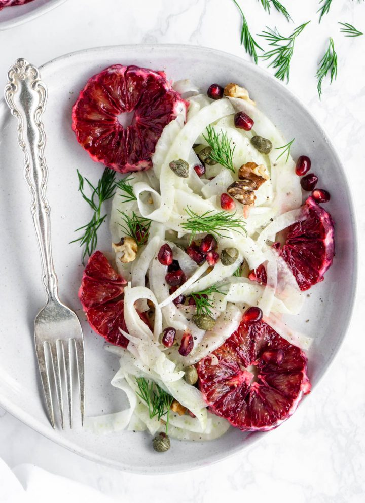 Overhead shot of a fennel salad with blood oranges in a plate