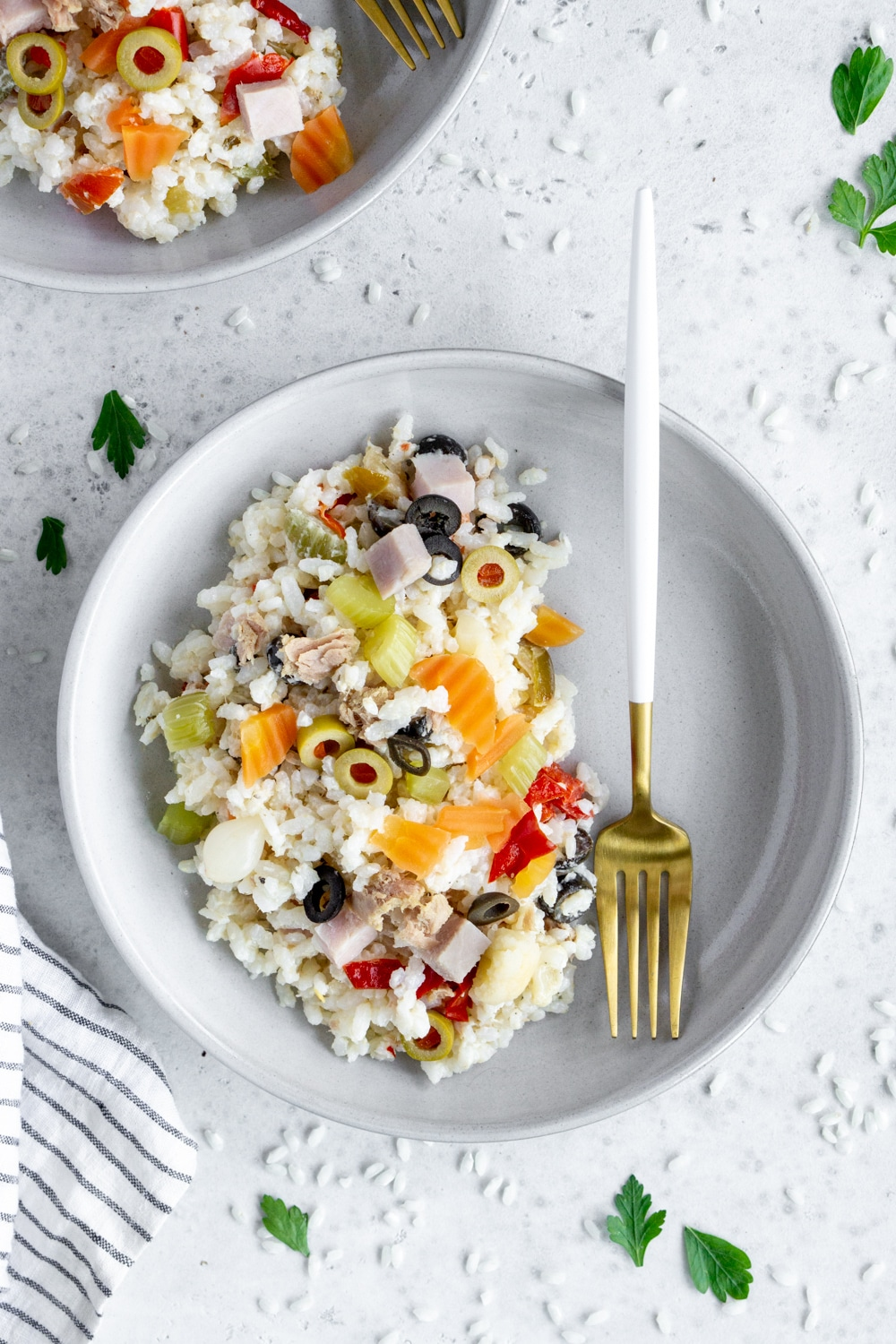 plate of rice salad (insalata di riso) with a fork in the plate
