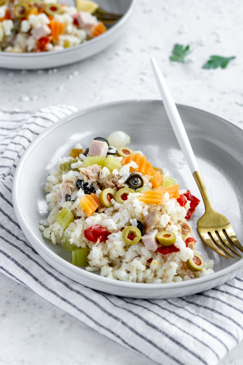 side view of a plate of rice salad on a napkin