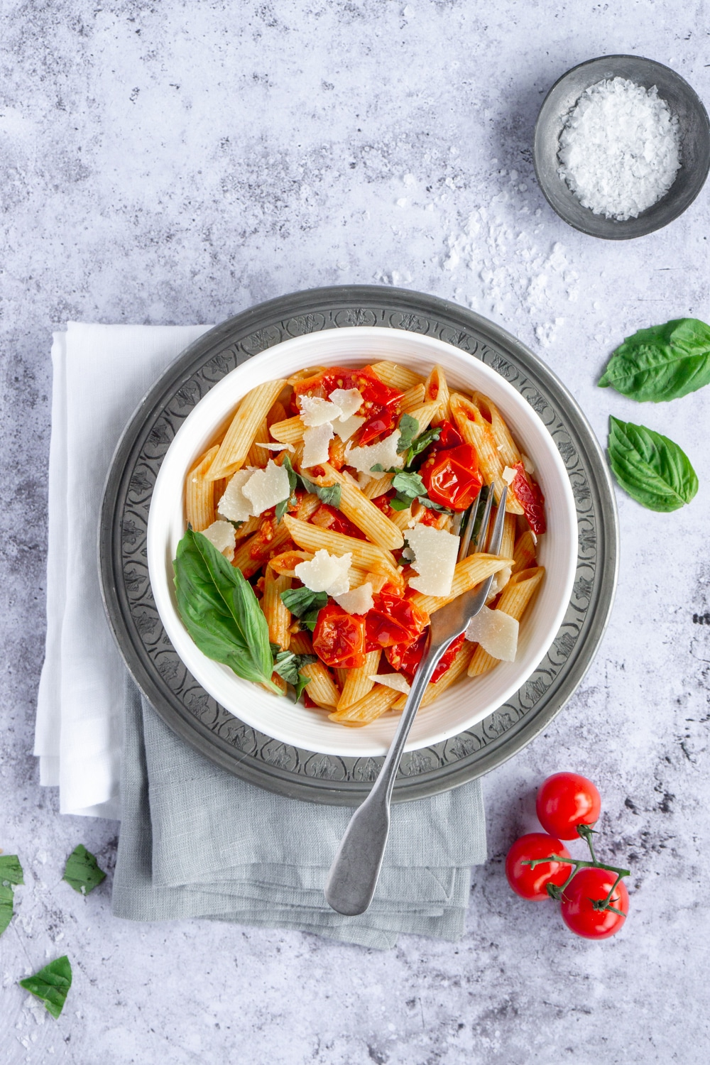 Pasta pomodoro in a bowl with a fork in the bowl