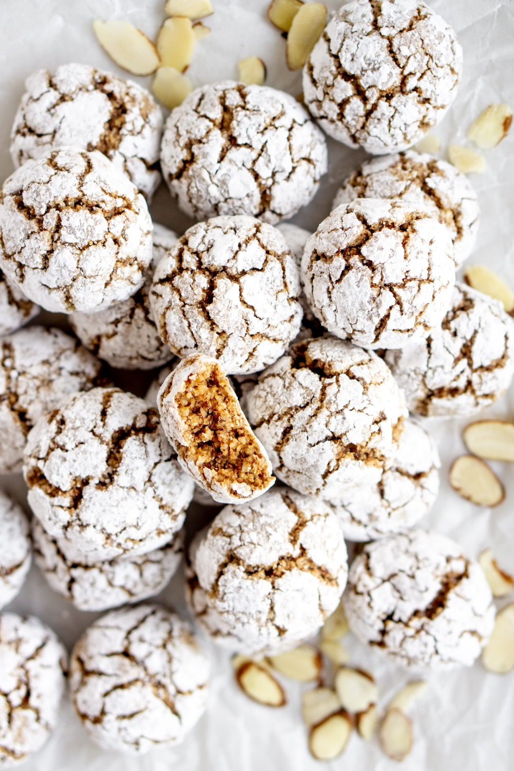Overhead shot of many amaretti cookies and sliced almonds
