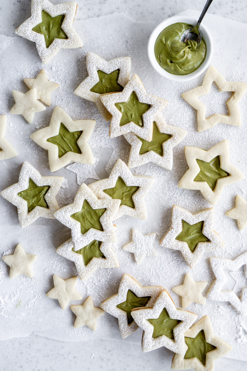 Grouped star cookies with a bowl of pistachio cream