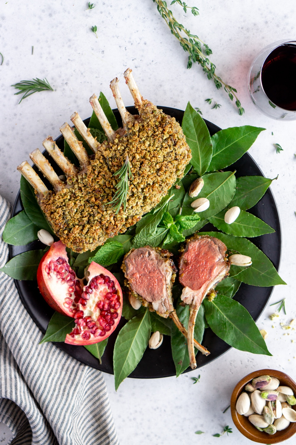 Roasted rack of lamb on a plate with two lamb chops