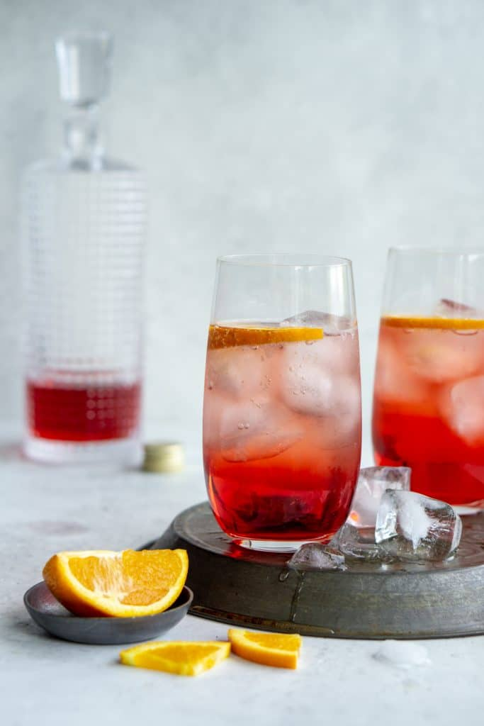 2 glasses of campari and soda on an inverted pie tin