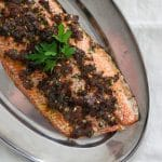 Sun dried tomato salmon on a metal serving tray