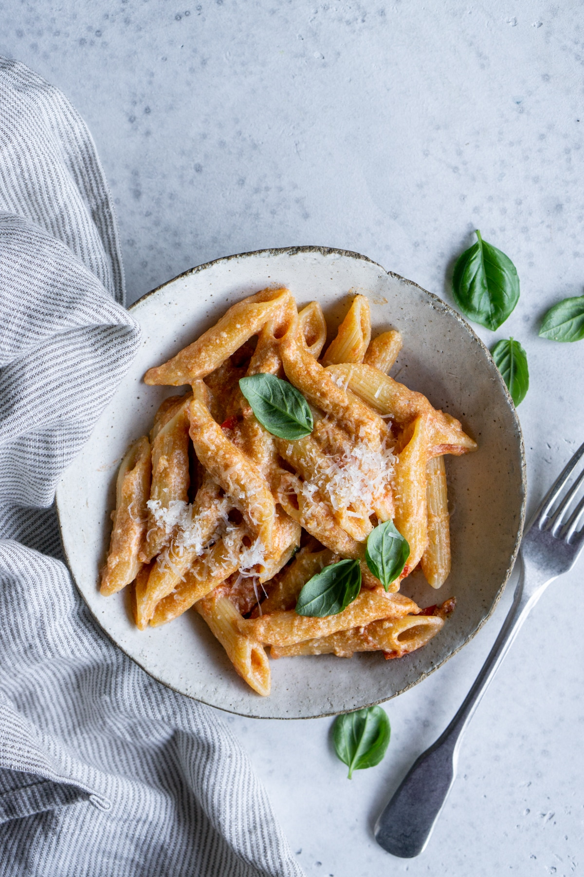 Ricotta pasta with tomato sauce in a bowl with a fork to the side